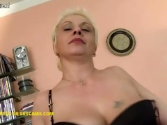 nasty housewife playing with her glass vibrator