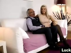 youthful girl in nylons positions for aged