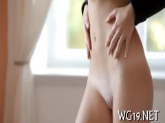 girl plays with large dildo