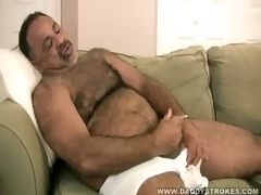 stocky dad plays with his cock
