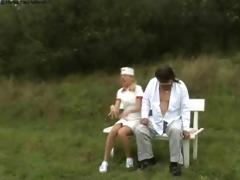 nurse treats old wang outdoors