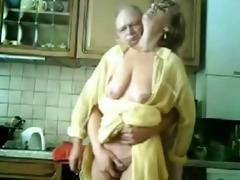 mamma and dad having joy in the kitchen. stolen