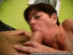 mature woman sucks on younger chaps schlong